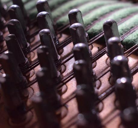 close up of piano tuning pins
