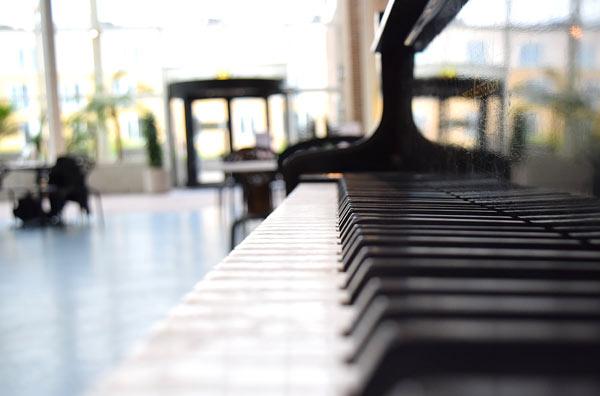 artist photo of a upright piano