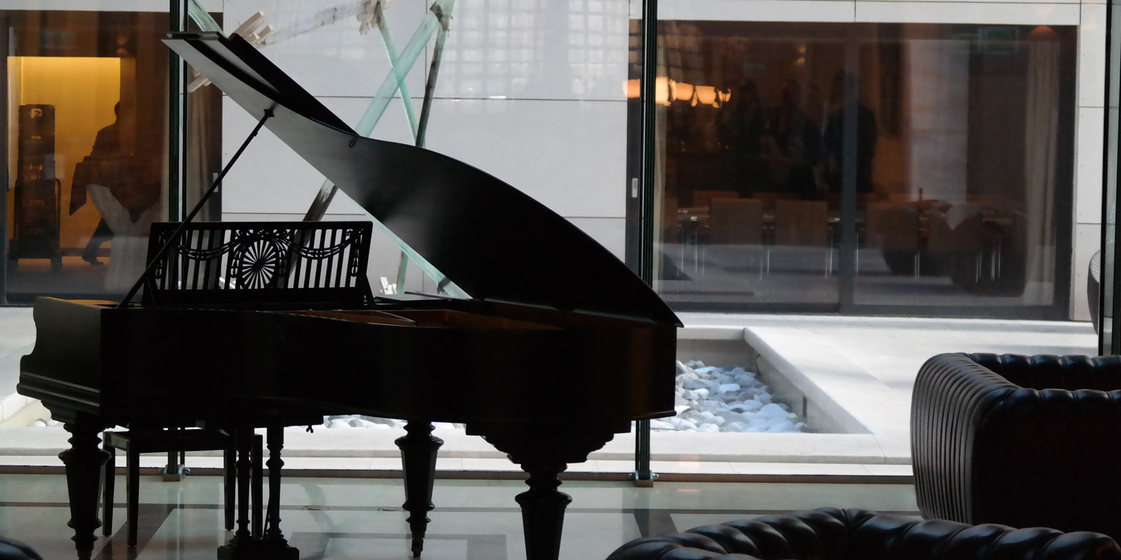 Grand Piano with Building in the Background