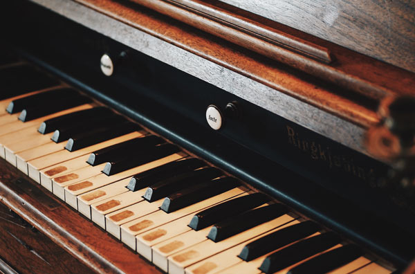 Old Wood Piano with finger prints on heavily used keys